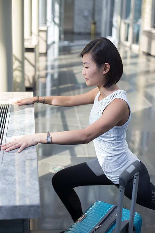 7 Travel-Friendly Exercises You Can Do At The Airport Leg Pulse