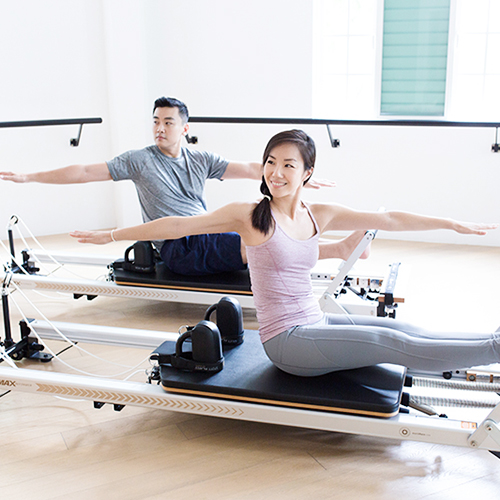 Upside Motion Pilates Reformer Couple Smiling