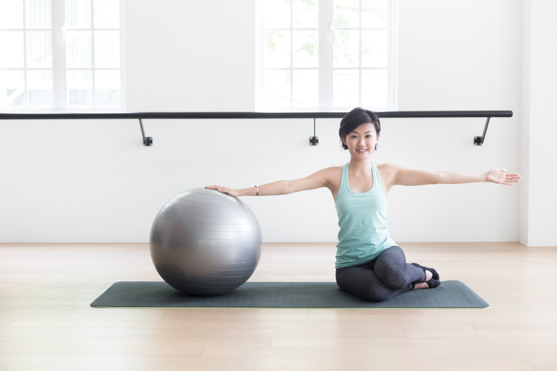 Anti-aging Pilates at Upside Motion side bend with fitness ball 1