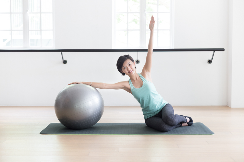 Anti-aging Pilates at Upside Motion side bend with fitness ball 2