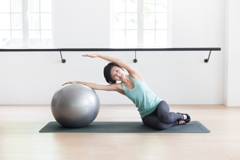 Anti-aging Pilates at Upside Motion side bend with fitness ball 3