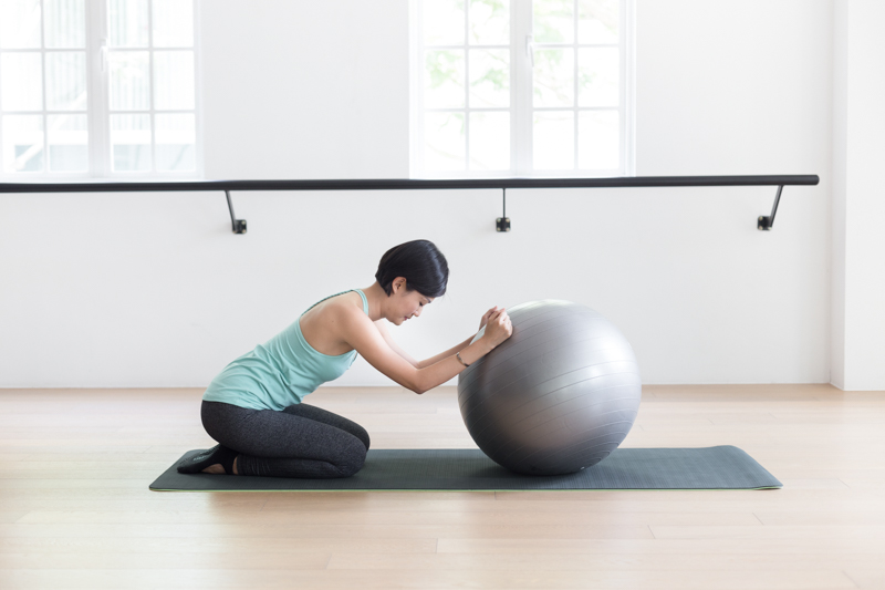 Anti-aging Pilates at Upside Motion modified cat-cow stretch with fitness ball 1
