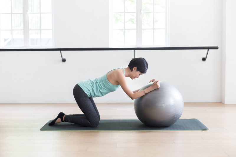 Anti-aging Pilates at Upside Motion modified cat-cow stretch with fitness ball 2