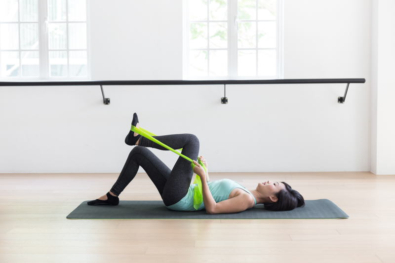 Anti-aging Pilates at Upside Motion leg stretches with flex bands 1