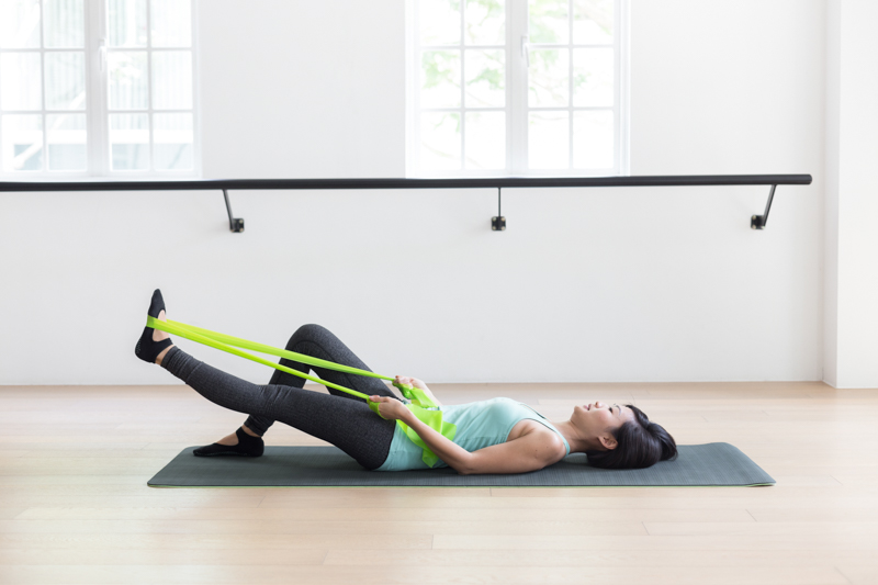 Anti-aging Pilates at Upside Motion leg stretches with flex bands 2