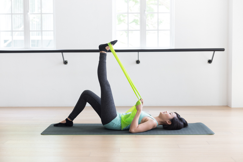 Anti-aging Pilates at Upside Motion leg stretches with flex bands 3