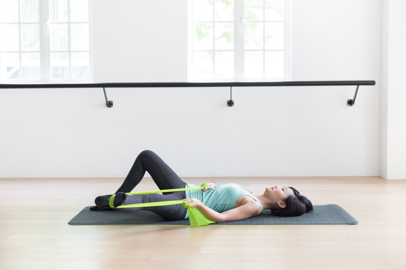 Anti-aging Pilates at Upside Motion leg stretches with flex bands 4